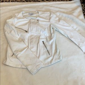 White leather jacket. With full zipper.